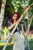 Redhead lady in urban environment Royalty Free Stock Image