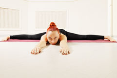 Redhead laying down on floor legs stretched Stock Images