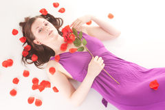 Redhead laying with rose Stock Photo
