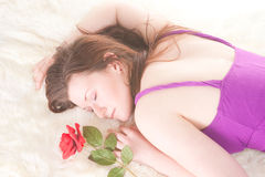 Redhead laying with rose Stock Photography