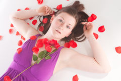 Redhead laying with rose Royalty Free Stock Photo