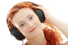 Redhead listening music Royalty Free Stock Photo