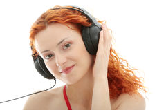 Redhead listening music Royalty Free Stock Photos