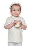 Redhead little girl with a glass of milk Stock Photos