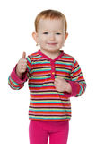 Redhead little girl holding her thumb up Stock Image