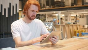 Redhead Man Typing Message in Cafe, Browsing on Tablet PC. 4k , high quality stock footage