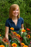 Redhead in Marigolds Royalty Free Stock Image