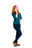 Redhead on mobile phone Royalty Free Stock Photo