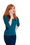 Redhead on mobile phone Royalty Free Stock Images