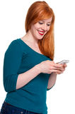 Redhead on mobile phone Stock Photos