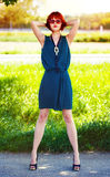 Redhead model posing at summer outdoor Royalty Free Stock Photography