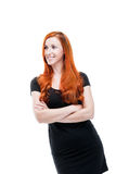 Redhead model standing with crossed arms Stock Photography