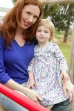 Redhead mother and blond daughter playing Stock Photo