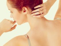 Redhead naked woman touching her hair and mouth. Nudity, beauty, skin and body care concept. Redhead woman in bra touching her hair and mouth Royalty Free Stock Photos