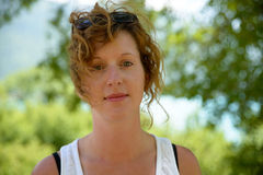 Redhead and natural woman in nature Royalty Free Stock Image