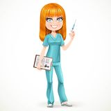 Redhead nurse in green suit preparing make an injection Stock Image