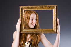 Redhead with picture frame Royalty Free Stock Image