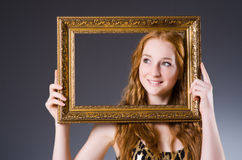 Redhead with picture frame Royalty Free Stock Photo