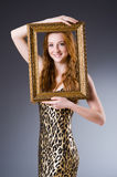 Redhead with picture frame Stock Images
