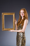 Redhead with picture frame Stock Photography