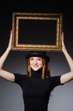 Redhead with picture frame Royalty Free Stock Images