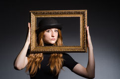 Redhead with picture frame Royalty Free Stock Photos
