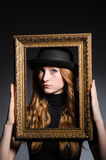 Redhead with picture frame Royalty Free Stock Photography