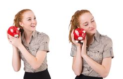 The redhead with piggybank isolated on the white Stock Photos