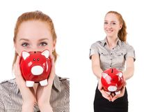 The redhead with piggybank isolated on the white Royalty Free Stock Photos