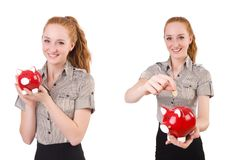 The redhead with piggybank isolated on the white Stock Images