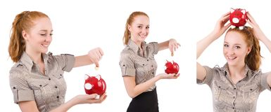 The redhead with piggybank isolated on the white. Redhead with piggybank isolated on the white Stock Photography