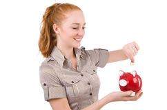 Redhead with piggybank Royalty Free Stock Image