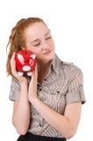 Redhead with piggybank Royalty Free Stock Image