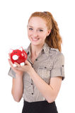 Redhead with piggybank Royalty Free Stock Photos