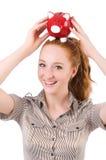 Redhead with piggybank Royalty Free Stock Photos