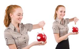 The redhead with piggybank isolated on the white. Redhead with piggybank isolated on the white Royalty Free Stock Photography