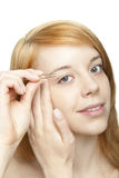 Redhead pluck eyebrows Stock Photography
