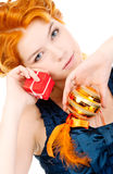 Redhead posing with christmas gift Royalty Free Stock Image