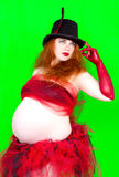 Redhead  pregnant woman  in hat Royalty Free Stock Images