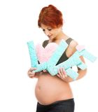 Redhead pregnant woman holding an inscription love Royalty Free Stock Photo