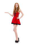 Redhead in red dress Stock Images