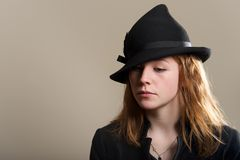 Redhead sad in black hat and jacket Royalty Free Stock Photo