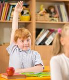 Redhead schoolboy behind desk Stock Images