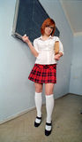Redhead schoolgirl in front of blackboard Royalty Free Stock Photo