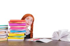 Redhead schoolgirl look out colored textbooks isolated on white background. Surprised girl in uniform is going to school. stock photo