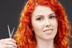 Redhead with scissors #2 Royalty Free Stock Image