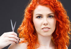 Redhead with scissors Stock Photo