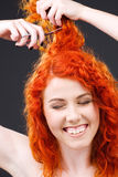 Redhead with scissors Stock Photos