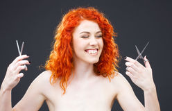 Redhead with scissors Royalty Free Stock Photos