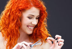 Redhead with scissors Stock Images